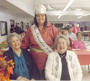 Miss Cherokee 2012 Karyl Frankiewicz (standing) visits during the annual Ned Long Day at the Cherokee Youth Center last month.  (Photo courtesy of Karyl Frankiewicz)