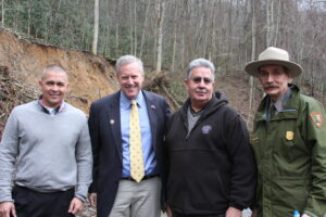 Tribal leaders toured the landslide site on Monday, Jan. 28 with Congressman Mark Meadows (R-NC) and Park officials.  Shown (left-right) are Principal Chief Michell Hicks, Congressman Meadows, Vice Chief Larry Blythe and Great Smokies Park superintendent Dale Ditmanson.  (LYNNE HARLAN/EBCI Public Relations)