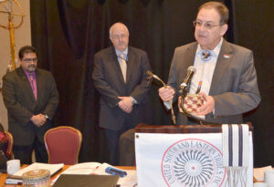 USET president Brian Patterson (right) makes a presentation of baskets and sweetgrass to FEMA Special Advisor for National Tribal Affairs Richard Flores (left) and FEMA Administrator Craig Fugate on Wednesday, Feb. 6 during the USET Impact Meeting in Washington.  (USET photo)