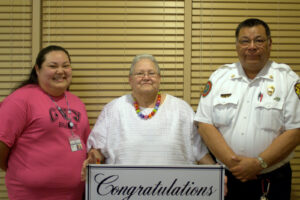 """Nancy """"Jim"""" Taylor (center) was honored at a retirement dinner last week.  She is shown here with her daughter, Kitty Taylor, and husband, Mernie Taylor.   (CBC photo)"""