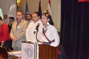 Teen Miss Cherokee Bradley Welch gives the opening prayer during Monday's USET meeting.