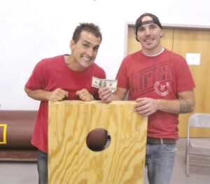 The Taylor Gang team, consisting of Heath Parton (left) and Rob Sims (right), of Canton, took third place.  They are shown with Johnny Wildcatt.