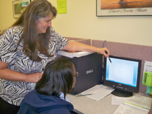 Instructor Penny Cody helps a student learn formatting for a Microsoft Word document as part of the Office Administration curriculum. (Photo by Holly Krake/OJCCCC)
