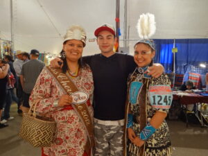MyGreen spokespersons, and EBCI tribal members, Hunter Thomas (center) and Dakota Brown (right) visit with Miss Cherokee Karyl Frankiewicz at the 2013 Gathering of Nations pow wow in Albuquerque.  (Photo courtesy of Shawn Spruce)