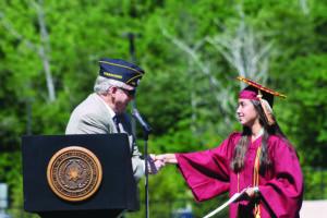 Steve Youngdeer American Legion Post 143 Commander Lew Harding presents the American Legion Award to Sabrina Wooten.