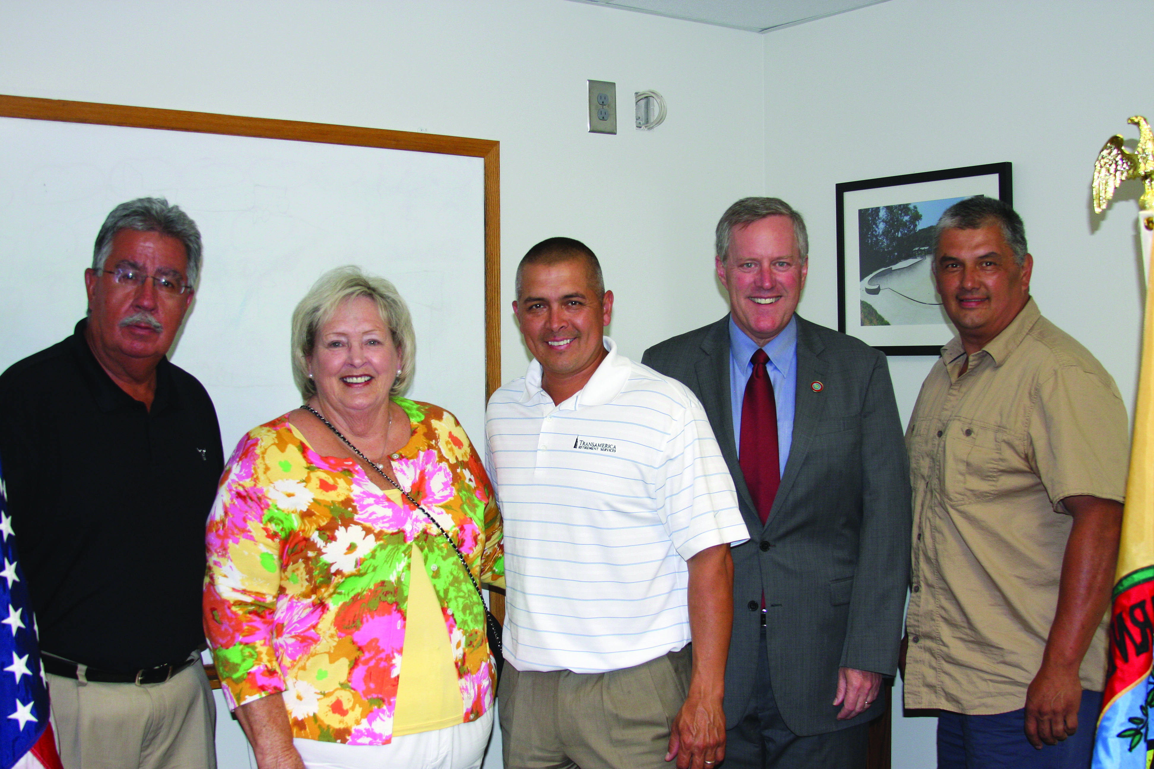 Congressman Mark Meadows (R-NC), shown 2nd from right, opened what is believed to the first Congressional office on an Indian Reservation in Cherokee on Tuesday, May 28.  Rep. Meadows was on hand to speak with EBCI tribal members, employees and leaders at Tuesday's event.  Shown (left-right) are Vice Chief Larry Blythe, Painttown Rep. Tommye Saunooke, Principal Chief Michell Hicks, Rep. Meadows and Yellowill Rep. B. Ensley.  (LYNNE HARLAN/EBCI Public Relations)