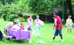 """Hula skirts and beach balls matched the island theme for Cherokee's 2nd Annual """"National HIVTesting Day"""" event and Health Celebration held at the Oconaluftee Island Park on Thursday, June 27. (J.D. ARCH/Commerce Intern)"""