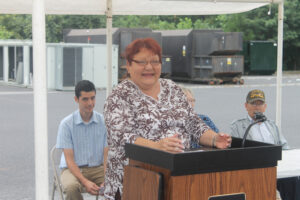 """Phyllis Ashenfelter, a Painttown Community member who works in the Office of the Vice Chief, speaks during Wednesday's event.  She called it """"a monumental day in Painttown history""""."""