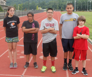 CMS cross country team (left-right) Isabelle Saunooke, Jimiqua Driver, Josiah Lossiah, Aniyah Younce, Logan Hux; not pictured – Tori Teesateskie, Jamie Lossiah, Shelby Wolfe and Shane Swimmer.