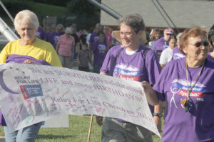 Nell Crowe, Julie Wilnoty and Lucille Wolfe lead off the Survivor's Lap at last year's Relay for Life of Cherokee event held at the Cherokee Indian Fairgrounds on July 27, 2012.  (SCOTT MCKIE B.P./One Feather)