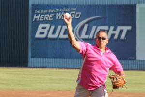 Chief Hicks throws out the first pitch at the Asheville Tourists Game on Saturday, Aug. 24.  (SCOTT MCKIE B.P./One Feather)