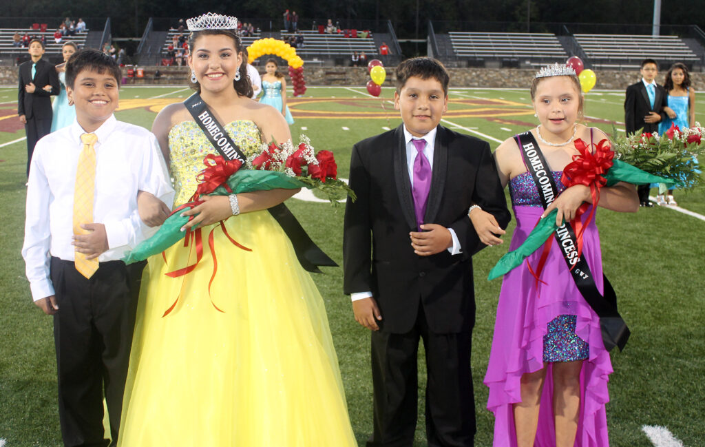 Timiyah Brown (2nd from left), escorted by Mikah Rosario (left), was named Cherokee Middle School Homecoming Queen during Homecoming festivities at Ray Kinsland Stadium on Thursday, Oct. 10.  Jacee Smith (right), escorted by Josh Girty (2nd from right) was named Homecoming Princess.  (SCOTT MCKIE B.P./One Feather)