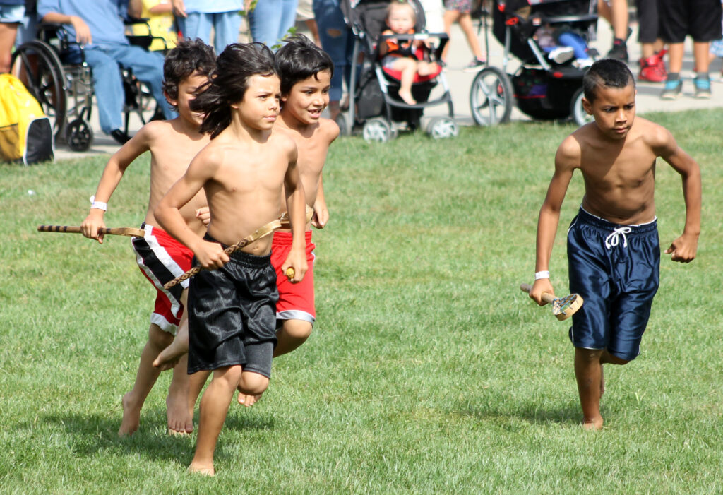 Big Cove played Wolftown in a youth (under 11) stickball game at the Cherokee Indian Fairgrounds on Wednesday, Oct. 2.  It was the first of two youth stickball games held during Children's Day of the 2013 Cherokee Indian Fair.  (SCOTT MCKIE B.P./One Feather)