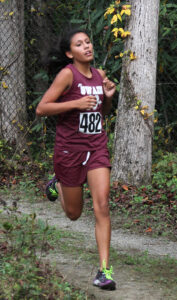 Swain's Shay Tisho, an EBCI tribal member, took first place in the middle school girls race.