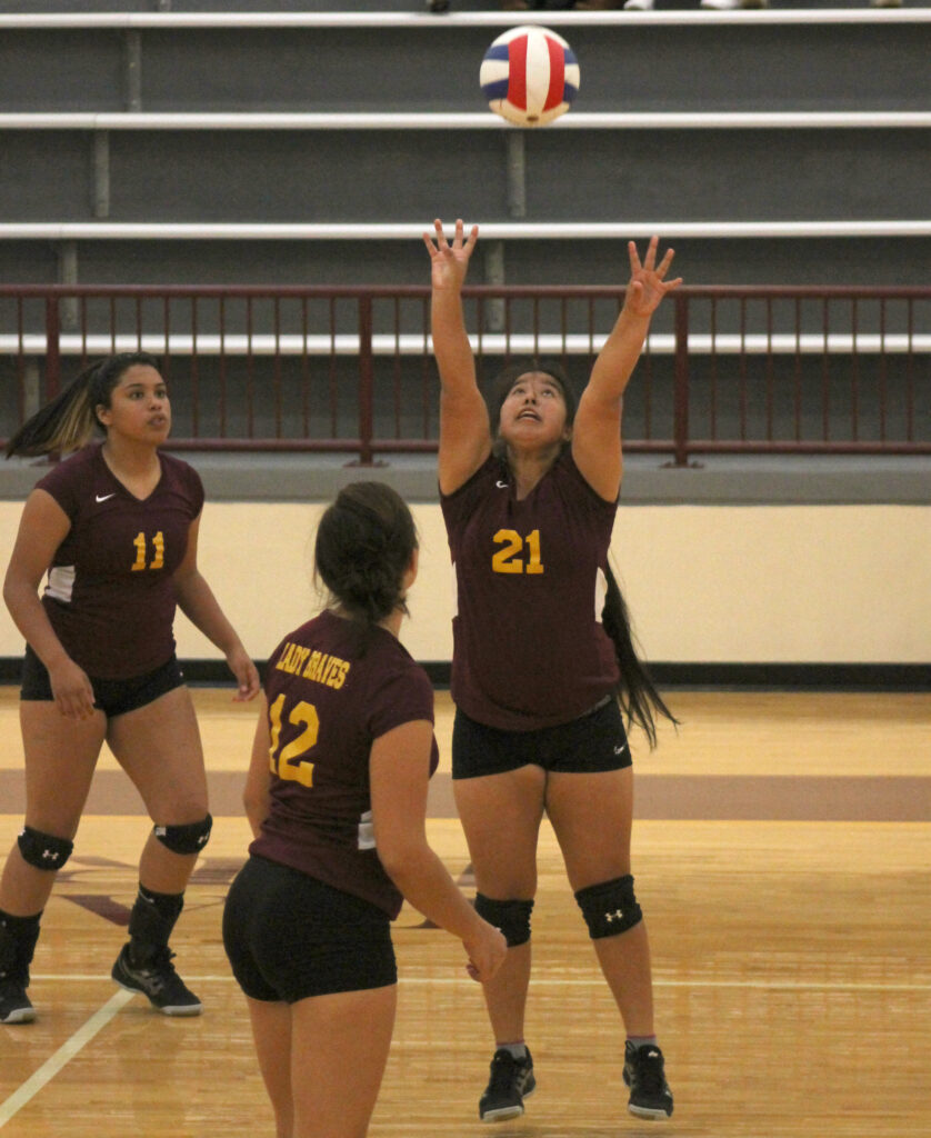 Kayla Bradley (#21) delivers a set in a match against Swain at home on Monday, Oct. 14.  (SCOTT MCKIE B.P./One Feather)