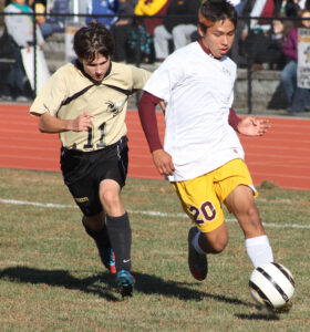Cherokee's Darius Thompson (#20) works by a Hayesville defender in a game last month.  Thompson has been selected to the Smoky Mountain All-Conference Soccer team.  (SCOTT MCKIE B.P./One Feather)