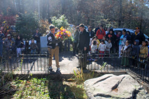 JLC chairman Tagan Crowe (right), of Cherokee High School, and JLC member Zane Wachacha, of Robbinsville High School prepare to lay a wreath at the gravesite of Junaluska during a ceremony on Friday, Nov. 8.  Wachacha is a direct descendant of Wachacha, Junaluska's brother.  (SCOTT MCKIE B.P./One Feather)