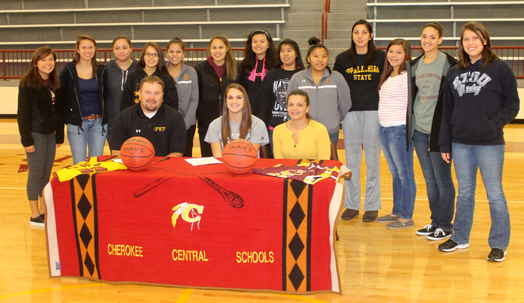 Members of the CHS Lady Braves varsity basketball team join Avery Mintz at her signing.