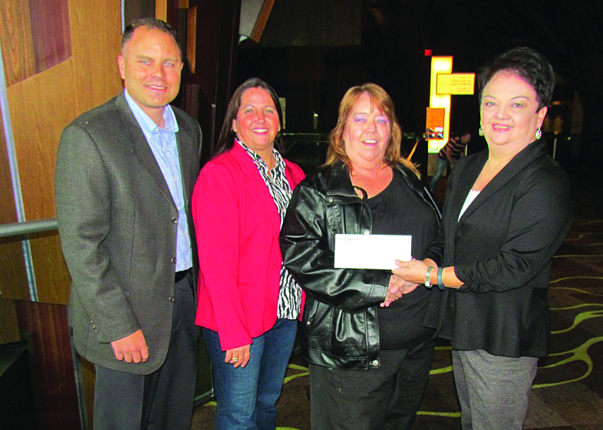 Harrah's Cherokee Casino Resort presented Hope for Families with a $3,000 donation on Friday, Nov. 8 to assist with the organization's services to families in Western North Carolina. Shown (left-right) are Jeff Cole, Hope for Families Board treasurer; VP Sandy Brown; Board president Zelerie Rose; and Jo Blaylock, Harrah's Cherokee Casino Resort vice president of human resources and external relations.  Hope for Families is a non-profit organization in Robbinsville that provides services to victims of sexual assault and domestic violence. The organization has a shelter, 24-hour crisis line, counseling, court advocacy, and support. Hope for Families' main source of financial support comes from its thrift store in Robbinsville. For more information about Hope for Families and its services, (828) 479-4612. (Harrah's Cherokee photo)