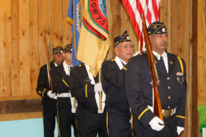 The Steve Youngdeer American Legion Post 143 Color Guard opens the program with the posting of the colors.