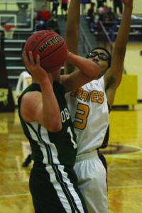 Cherokee's Brandt Sutton (#3) plays tough defense against Blue Ridge.
