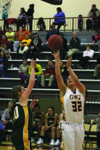 Cherokee's Peri Wildcatt (#32) goes around a Lady Rockets defender.  (SCOTT MCKIE B.P./One Feather photos)