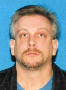 James Quilliams Age: 40 Height: 6'2 Weight: 215 lbs. Hair:  Short, gray with a goatee Clothing: Black trench coat, black dress pants, tennis shoes (Photo courtesy of NPS)