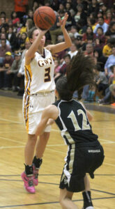 Kendall Toineeta shoots a jump shot over Hayesville's Savannah Anderson (#12).  Toineeta finished the game with 16pts, 7 rebounds and 2 steals.