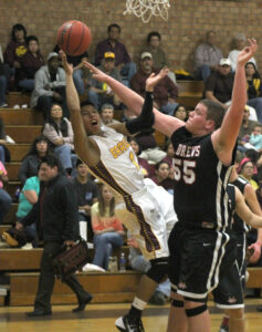 Jason McMillan (#1) takes a hard foul from Andrews' Aaron Devore (#55) in the first half of Thursday's game.  McMillan had 13pts in the game.