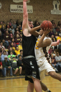 Kennan Panther drives to the basket against Robbinsville's Jesse Franks (#5).