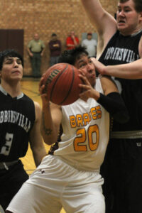 Darius Thompson (#20) squeezes between Robbinsville's Cruz Galaviz (#3) and Jesse Franks (#5) as he drives to the basket during Friday's final of the SMC tournament.