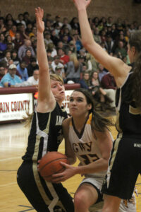 Avery Mintz drives between two Hayesville defenders including Amanda Thompson (#20) and Stephanie Patton (#32).  Mintz finished the game with 26pts, 10 rebounds and 2 steals.  (SCOTT MCKIE B.P./One Feather photos)