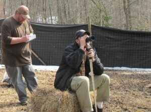 Environmental specialist Dallas Bradley (left) and supervisory biologist, Dr. Caleb Hickman (right), of the Eastern Band of Cherokee Indians Fisheries and Wildlife Management Department, observe a herd of 38 white tail deer that are being reintroduced into the wild by the Tribe on Monday. (Photo credit: Eastern Band of Cherokee Indians)