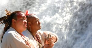 Bo Taylor (front) and Ty Oocumma (back), members of the Warriors of Anikituwah, are shown dressed in traditional clothing.   (Photo contributed)