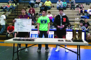 Cherokee's Jaron Bradley (left) is awarded first placed in the 152lb division.