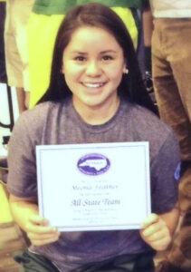 EBCI tribal member Meona Feather holds her NCISAA All-State Certificate.  (Photo courtesy of Rabun Gap)