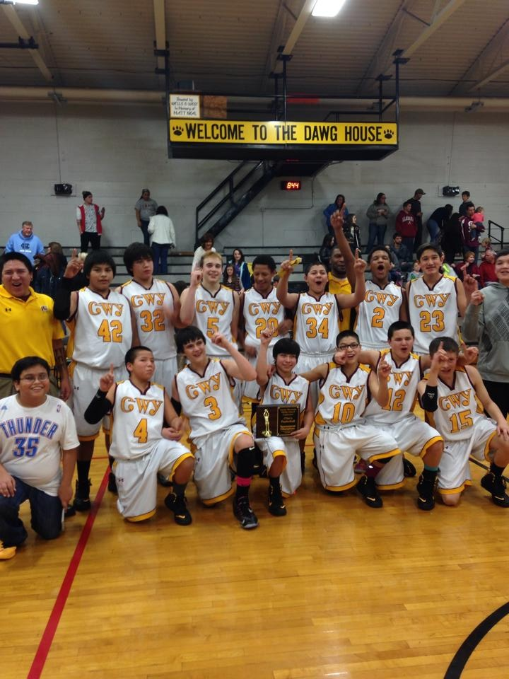 The Cherokee Middle School Braves basketball team celebrates winning the Smoky Mountain Conference tournament on Thursday, Feb. 6 at Murphy High School.  Shown (left-right) standing – coach Micah Swimmer, Zak Perez, Isaiah Bradley, Tye Mintz, Nate Evans, Sterling Santa-Maria, coah Spencer Moore, Isaiah Evans, Nolan Arkansas, manager Dorian Martens; kneeling – manager Elijah Rosario, Kyler Hill, Holden Straughan, Carson Wildcat, Josiah Lossiah, George Swayney, and Shannon Albert.   (Photo contributed)