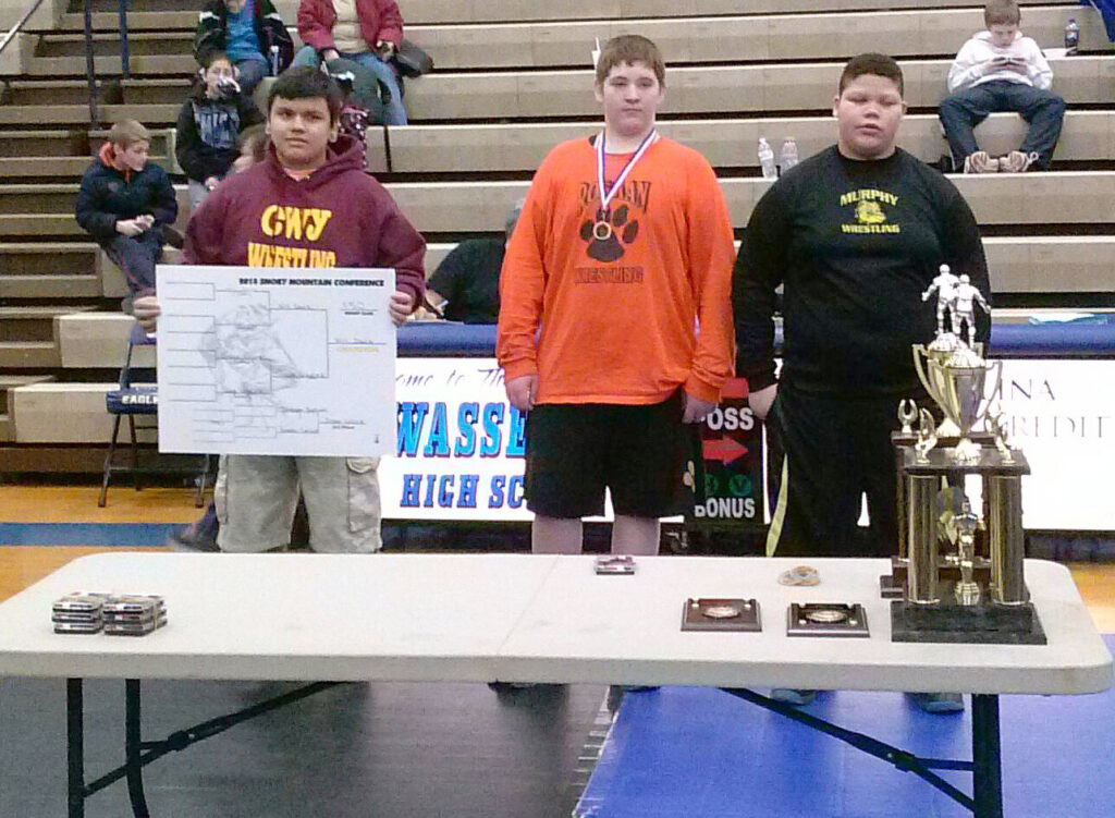 Cherokee's Will Davis (left) holds the bracket for the 250lb division he won at the Smoky Mountain Conference Middle School wrestling tournament at Hiwassee Dam on Saturday, Feb. 1.  (Photo courtesy of Anthony Swearengin)