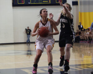 Kendall Toineeta (#3) drives to the basket against a Hayesville defender.  She finished the game with 11pts.  (AMBLE SMOKER/One Feather photos)