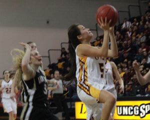 LeLe Lossiah (#5) drives the lane for a lay-up after a fast break during Saturday's game.  She ended the game with 4pts.