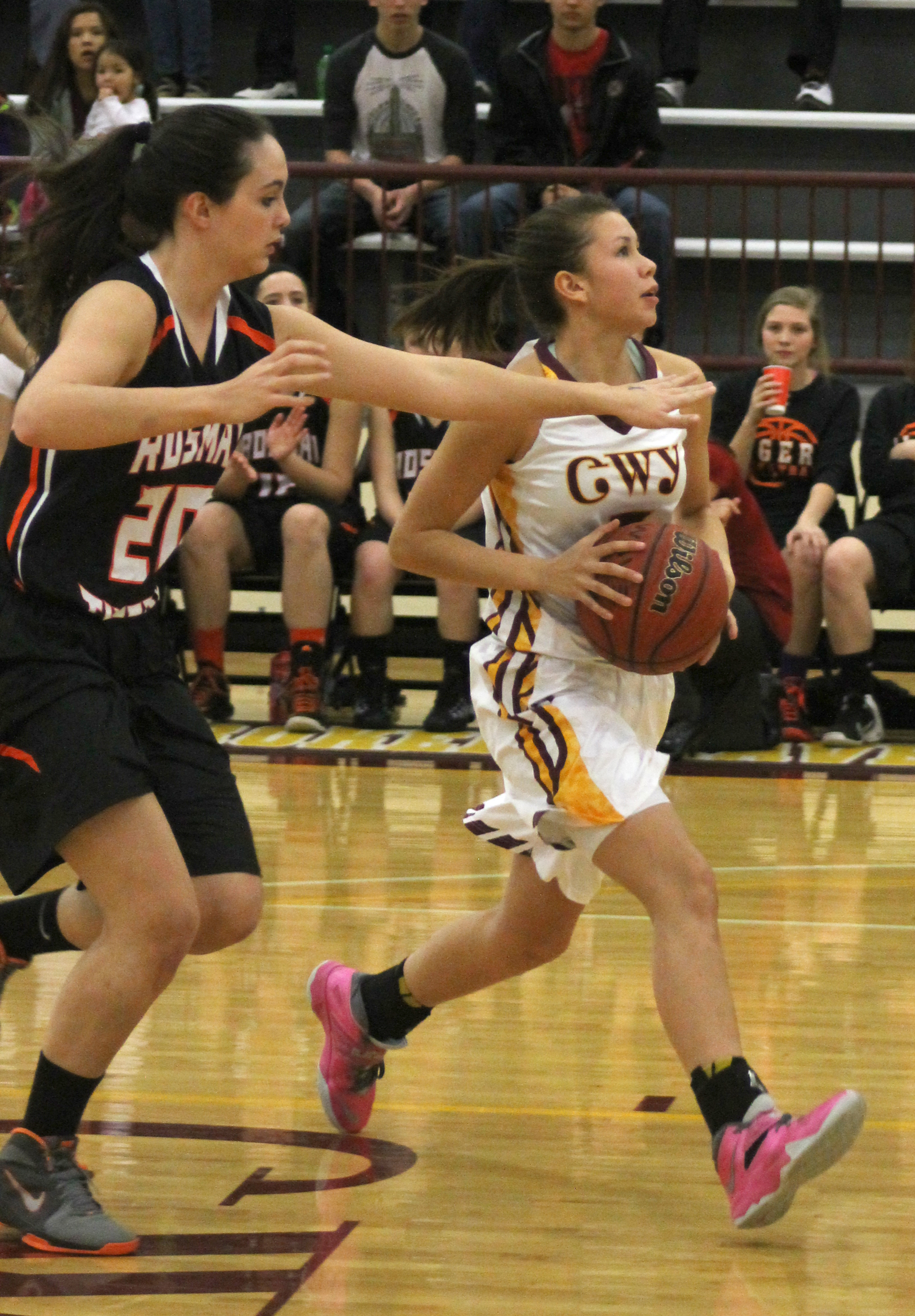 Kendall Toineeta runs past Rosman's Selina Hoxit (#20) en route to a lay-up in the first period of Friday's game.  Toineeta led Cherokee with 32pts, 7 rebounds, and 11 steals.