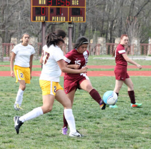 Swain's Haley Cooper (#15) kicks a ball just out of the reach of Kyleigh Wiggins (#27)