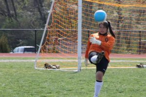 Cherokee goalkeeper Anna Cline punts a ball out following a save.  She played another solid match.