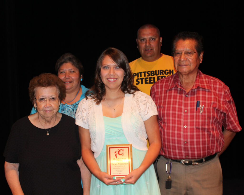 CHS Class of 2014 co-Valedictorian Taran Swimmer (front center), shown with her family, was among the senior honorees at the CHS Academic Awards program on Tuesday, May 27.  (AMBLE SMOKER/One Feather)