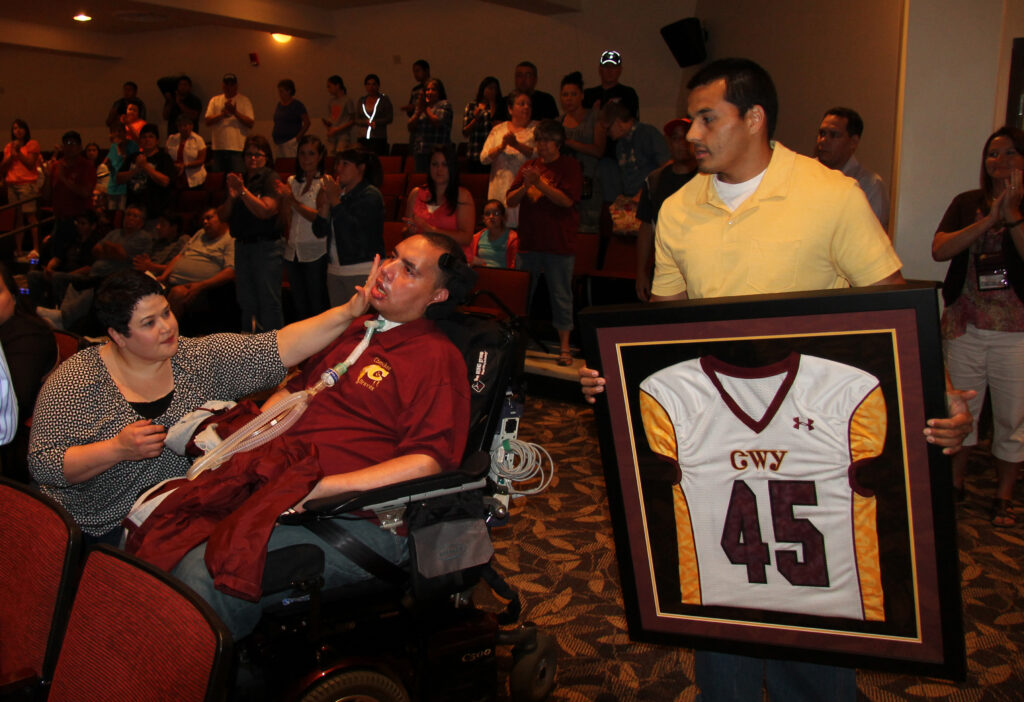 Rod Cooper receives a standing ovation as his #45 jersey is retired during Friday's event.