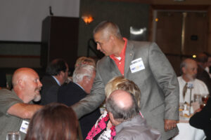 Principal Chief Michell Hicks greets some of the more than 225 attendees at Thursday's Summit.