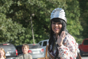 Miss Cherokee 2013 Madison Crowe waves during last year's Cherokee Indian Fair Parade.  This year's parade is scheduled for Tuesday, Oct. 7.