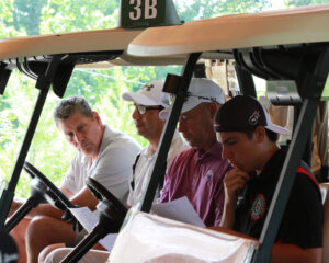 The team of Bud Smith, Curtis Wildcatt, PGA Professional Rick Morton, and Tagan Crowe receive last minute instructions before tournament play.