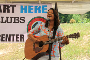 EBCI tribal member Stephanie Brown sings at the opening of the Center.