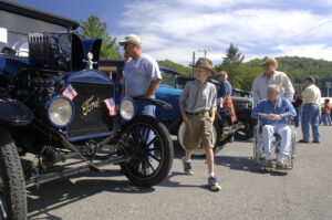 Duncan LeMay, of Cullowhee, walks around and admires a 1923 Ford Touring during the antique car show during the 2013 Mountain Heritage Day Festival on Saturday.